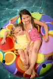 Children girls swim water Royalty Free Stock Photos