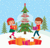 Children give Christmas gifts Royalty Free Stock Photography