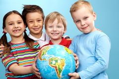 Children with globe Stock Photography