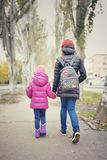 Children go holding hands, child and teenager, Stock Images