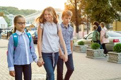 A children go to school holding hands. Children go to school holding hands. Urban background Stock Photography