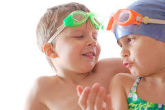 Children with goggles talking. Two kids with goggles on their heads talking royalty free stock images