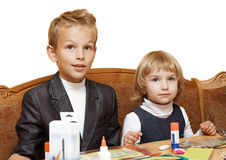 Children are going to do homework. The brother with the sister behind a desktop Royalty Free Stock Images