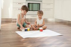 Boys are going to paint with gouache paints. royalty free stock photo