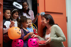 Children Going Trick Or Treating With Mother royalty free stock photos