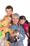 Children with grandma. Affectionate children with grandma and cat. Family portrait Stock Images