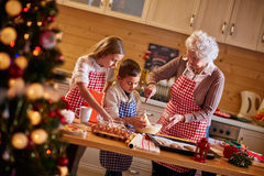 Children and grandmother preparing Christmas cookies. Children and grandmother preparing  cookies- time Stock Photos