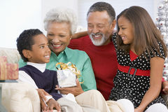 Children With Grandparents At Christmas royalty free stock images