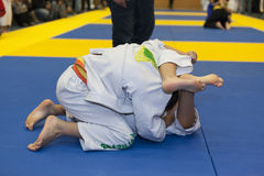 Children grappling Stock Images