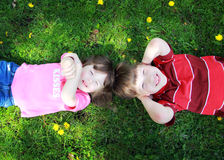 Children on Grass Royalty Free Stock Photography