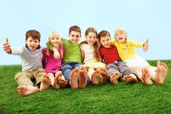 Children on grass royalty free stock photo