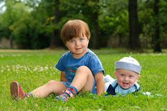 Children in grass stock photo