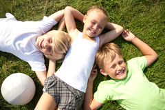 Children on grass Royalty Free Stock Images