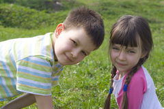 Children in grass Royalty Free Stock Images