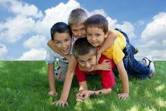 Children on the grass Stock Photography