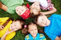 Children on grass Royalty Free Stock Photos
