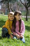 children on grassy hillside royalty free stock image