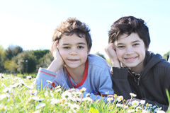 Children on green grass Stock Photography
