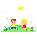 Children on a green meadow with flower Royalty Free Stock Photography