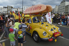 Children greet the lifeguards in the Margate Carnival. MARGATE,UK-August 6: Children greet the Thanet Lifeguards in their car with skateboards. taking part in royalty free stock photo