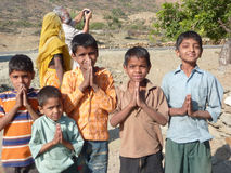 Children greet visitors with namaste Royalty Free Stock Image