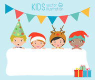 Children and greeting Christmas and New Year card, kids peeping behind placard, kids in Christmas costume characters celebrate Royalty Free Stock Photo