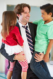 Children Greeting Father On Return From Work. Smiling To Him stock photography