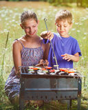 Children grilling vegetable. Royalty Free Stock Photo