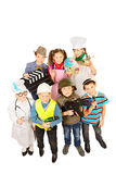 Children group. A group of children dressed in costumes of different professions. Isolated over white Royalty Free Stock Photography