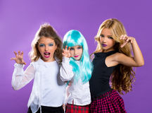 Children group of fashiondoll scaring girls on purple Royalty Free Stock Photos