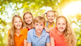 Children Group Five Persons, Kids Girls and Boy Portrait, Pupils. Looking at Camera over Green Nature Background Royalty Free Stock Photography