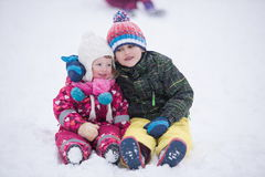 Children group  having fun and play together in fresh snow Stock Image