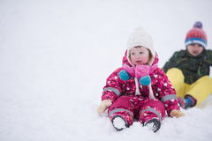 Children group  having fun and play together in fresh snow Royalty Free Stock Image