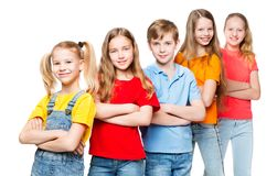 Children Group, Kids on White, Happy Smilling People in colorful t-shirts royalty free stock photos