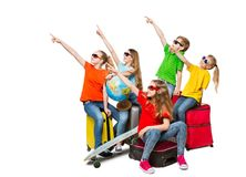Children Group Pointing Travel Destination, Teens in Sunglasses. Sitting on Trip Suitcases, Kids Isolated over White Background Royalty Free Stock Photos