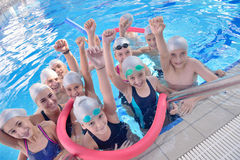 Children group at swimming pool. Group of happy kids children at swimming pool class learning to swim royalty free stock images