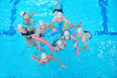 Children group at swimming pool. Group of happy kids children at swimming pool class learning to swim stock image
