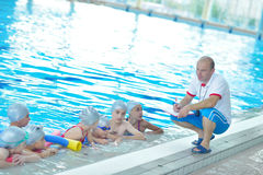 Children group at swimming pool. Group of happy kids children at swimming pool class learning to swim stock photography
