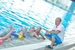 Children group at swimming pool. Group of happy kids children at swimming pool class learning to swim stock photos