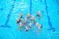 Children group at swimming pool. Group of happy kids children at swimming pool class learning to swim royalty free stock image