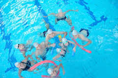 Children group at swimming pool. Group of happy kids children at swimming pool class learning to swim royalty free stock photo