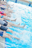 Children group at swimming pool. Group of happy kids children at swimming pool class learning to swim royalty free stock photography