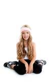 Children gym little blond girl posing in studio Royalty Free Stock Images