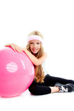 Children gym yoga girl with pilates pink ball Royalty Free Stock Photography