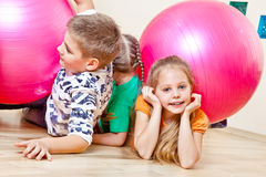 Children with gymnastic balls. Cute children playing with large gymnastic balls Stock Image