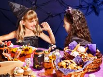 Children on Halloween party . Children on Halloween party  sitting at trick or treat table Stock Photography