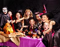 Children on Halloween party making pumpkin Stock Images
