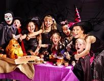 Children on Halloween party making pumpkin. Children on Halloween party  making carved pumpkin Stock Images