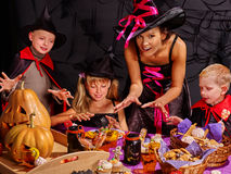 Children on Halloween party making pumpkin Stock Photography