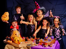 Children on Halloween party making pumpkin Jack OLanten. Royalty Free Stock Photo